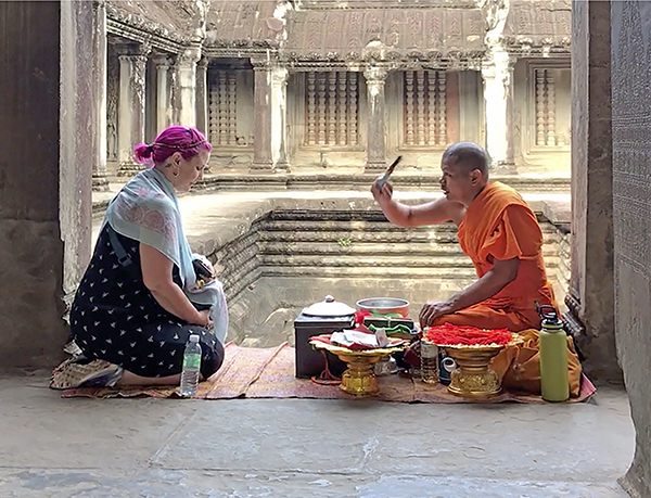 Foto Friday - a Buddist monk blessing a woman with purple hair