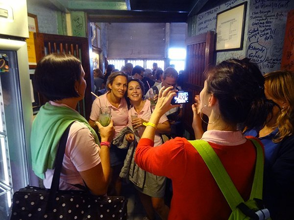 Foto Friday - women in a bar taking photos