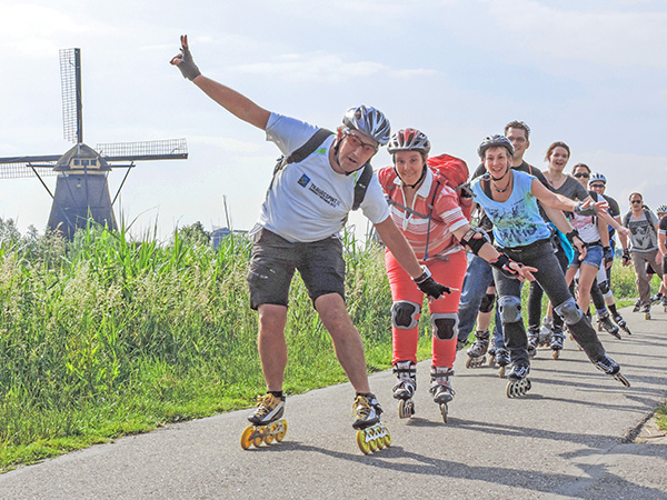 Foto Friday - roller skaters by a windmill