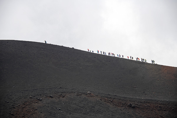 Foto Friday - silhouette of people walking along a distant ridge