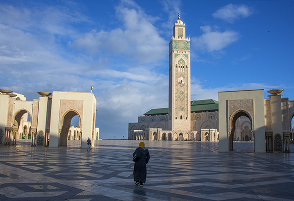 Foto Friday - people walking by a large minaret and mosque