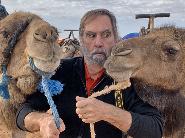 Foto Friday - a man with camels-