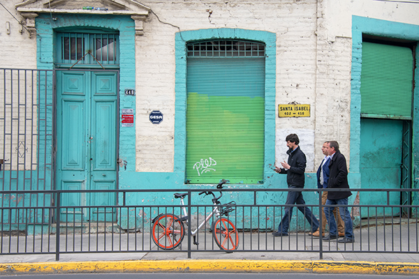 Foto Friday - three men waling past a brightly painted old building