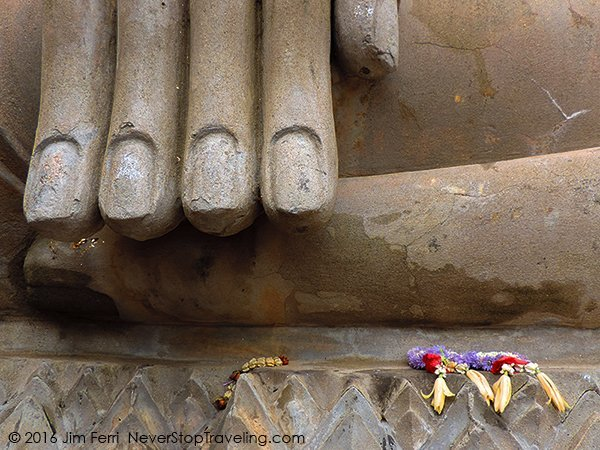 Foto Friday - large fingers of a Buddha with flowers