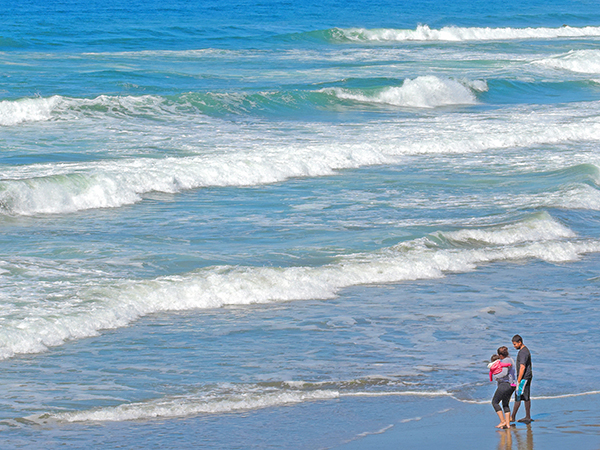 Foto Friday - a family wading along an ocean beach