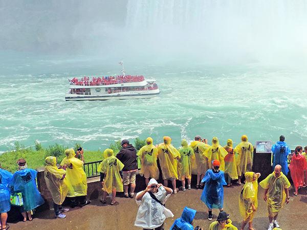 Foto Friday - people watching a tour boat under a large waterfall
