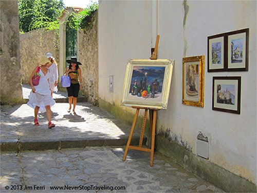 Foto Friday - women passing art on a builsing Ravello, Italy