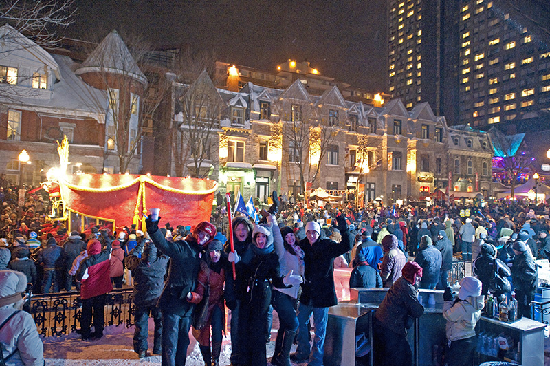 people in the snow at one of Canada's winter festivals