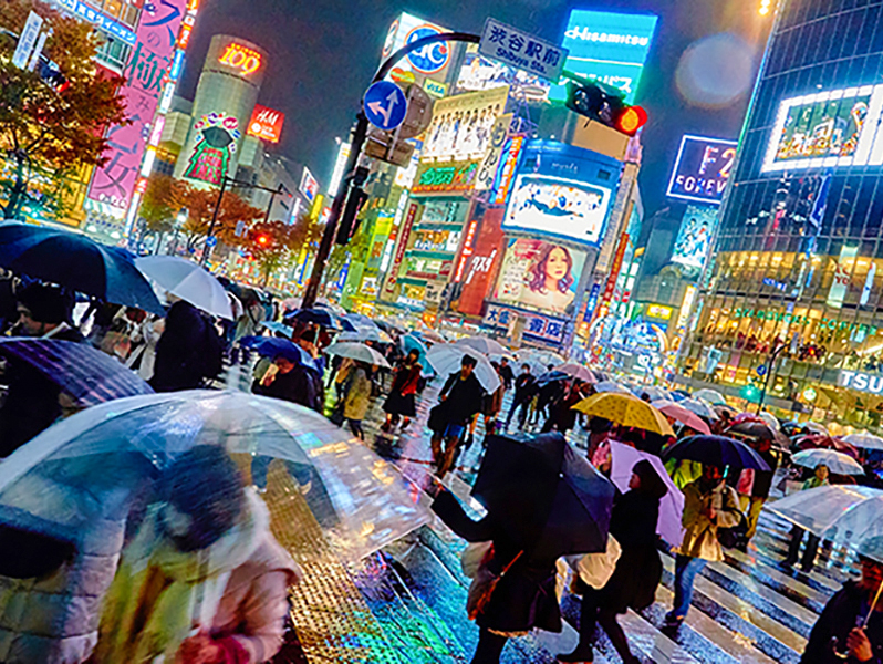 people in a rain storm in Japan
