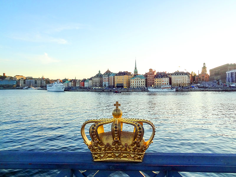 a crown on a bridge by a harbor top 10 sweden
