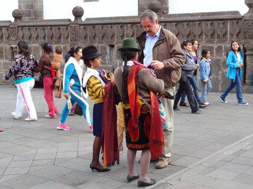 Indian women and tourist in Quito's old city, Ecuador
