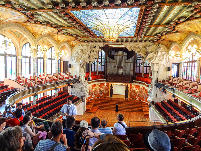 people in an ornate music hall in Bracelona