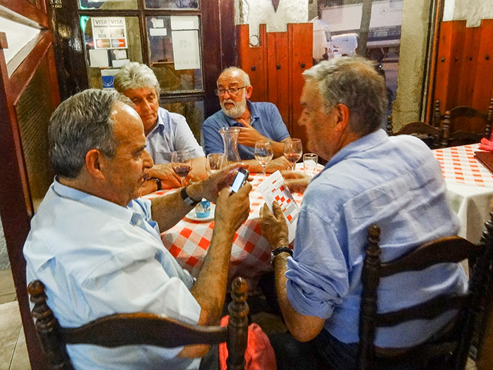local men at the restaurant El Pa I Trago, a good place to eat in in Bracelona