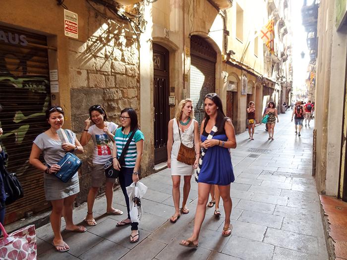 young wom a street in Bracelona alongen walking