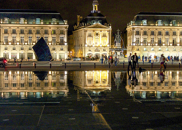 buildings reflected in a river in Bordeaux