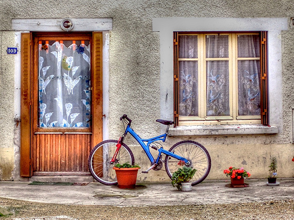 a bicycle by an old house