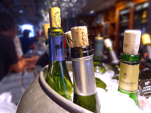 wine bottles in an ice bucket - home exchanges - farm stays
