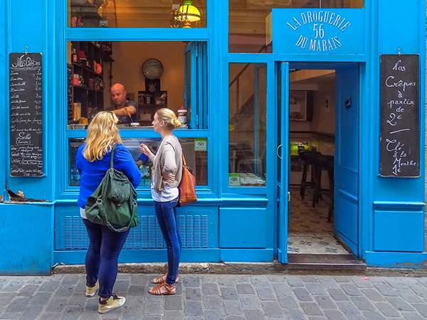 two women in front of a building creperie in Paris, one of the best places to visit in France
