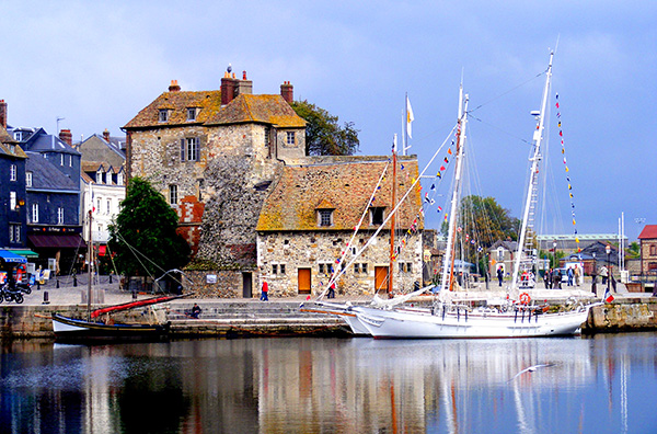 boats in an old harbor in Honfleur, one of the best places to visit in France