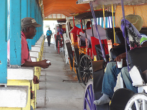 Carriage drivers outside the cruise-pier building in the Bahamas
