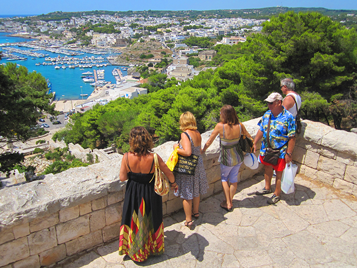 people on hill over a town in Puglia, Italy