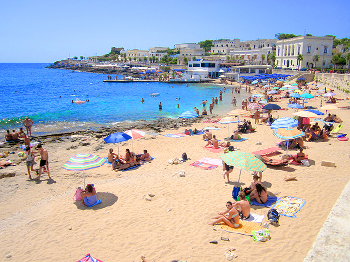 people on a beach in Puglia, Italy