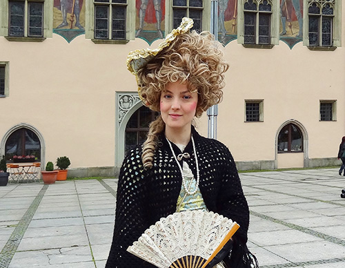 A tour guide outside Passau's Rathaus in Passau