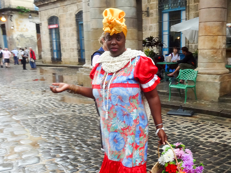 a woman in a bright dress in Havana
