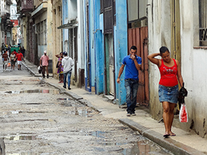people walking along a street in Havana