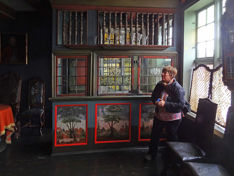 A woman in a museum, one of the things to do in Bergen Norway
