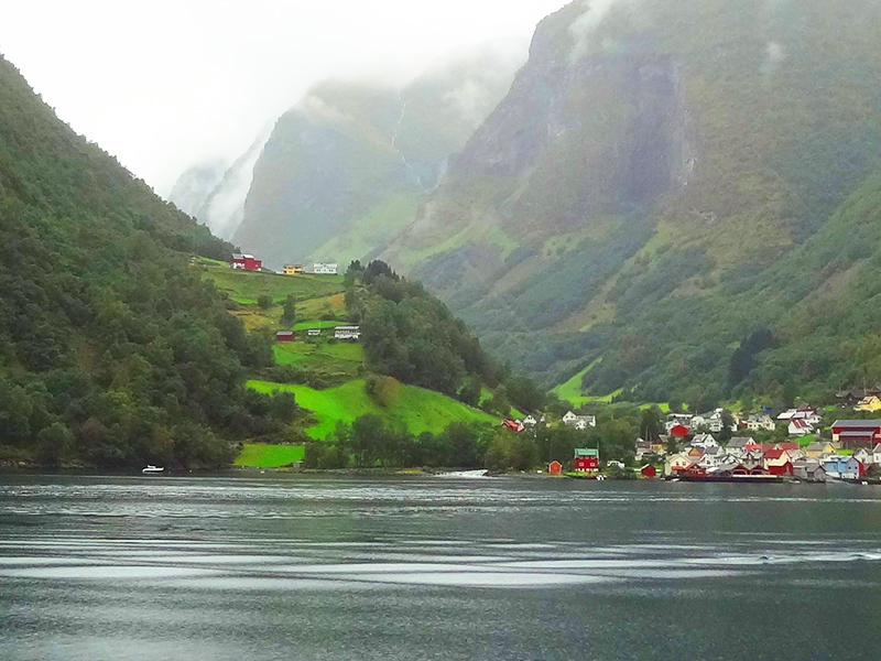 a town on a bay seen on fjord tours from Bergen