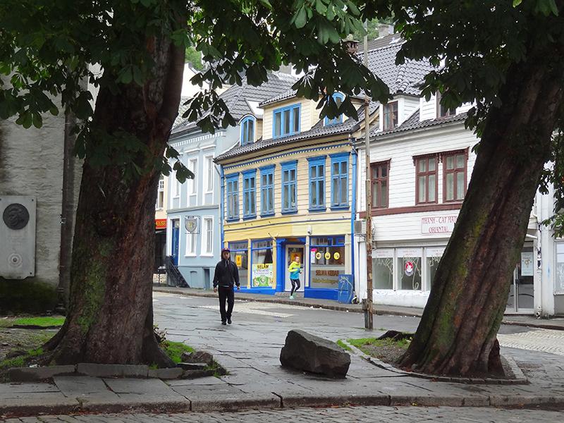 a man walking along a street reached from Bergen airport