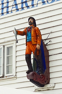 A ship figurehead on a building in Bergen, Norway