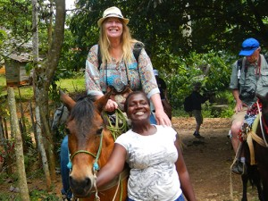 woman on horse riding to El Limon Waterfalls in Samana Dominican Republic / photo: Carla Marie Rupp