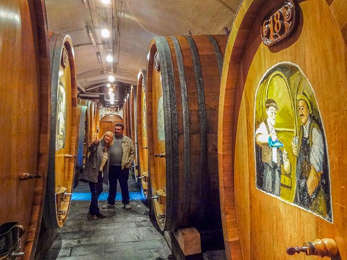 people by casks in a wine cellar in the Lavaux in Switzerland
