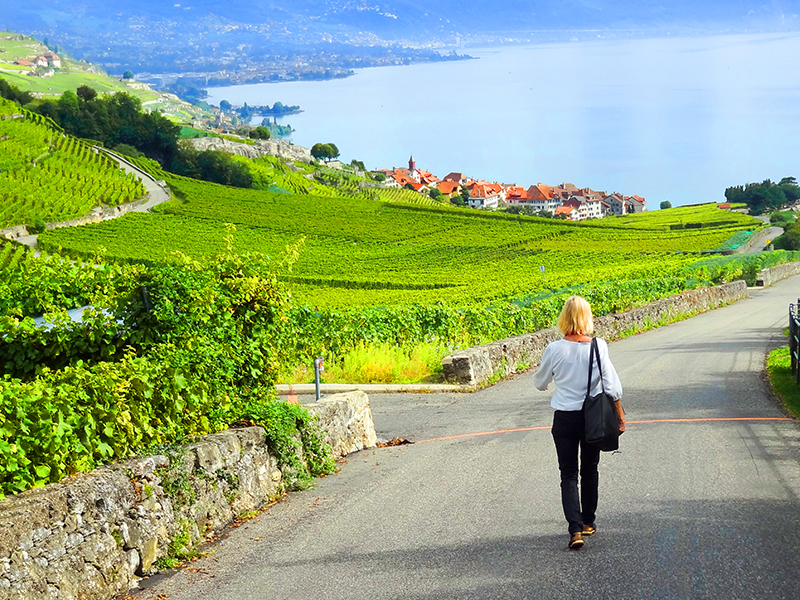 woman walking on a road in the Lavaux in Switzerland