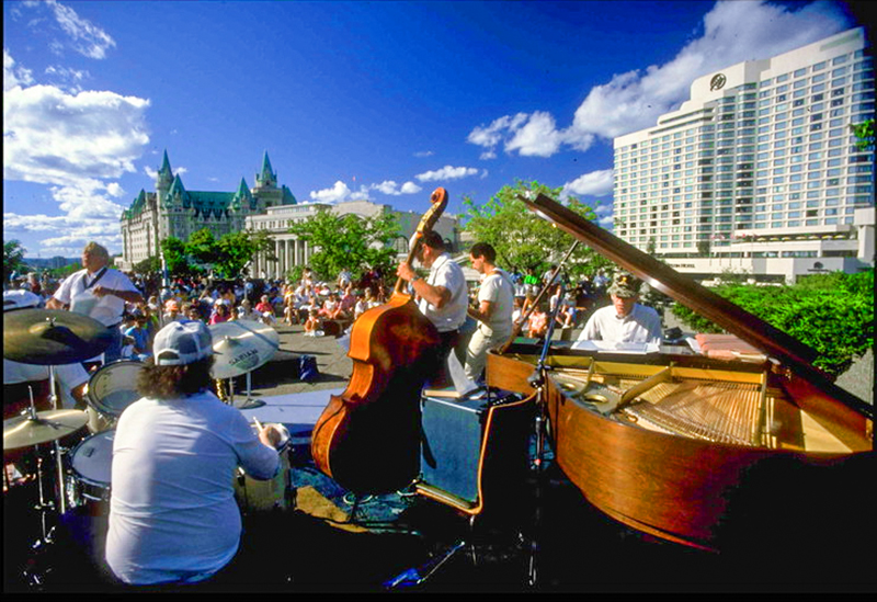 musicians in a park at a jazz festival