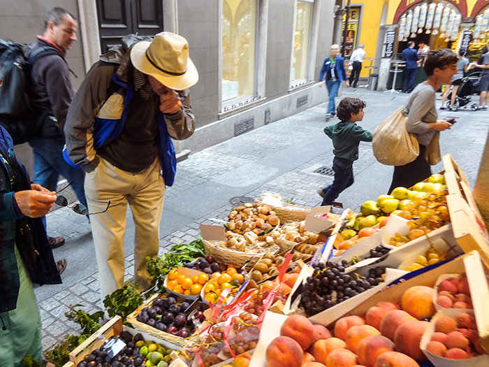 man in a market in the old city, one of the best things to do in Lugano Switzerland