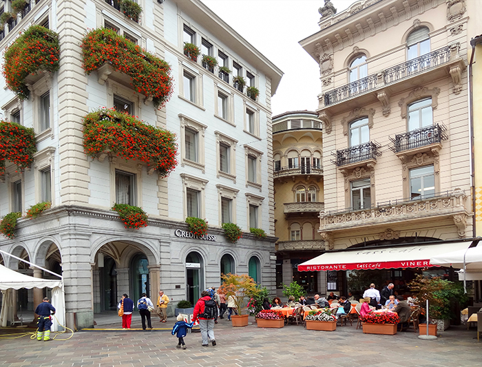 cafes in an old city square, one of the best things to do in Lugano Switzerland