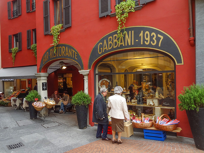 two women looking in a shop window, one of the best things to do in Lugano Switzerland