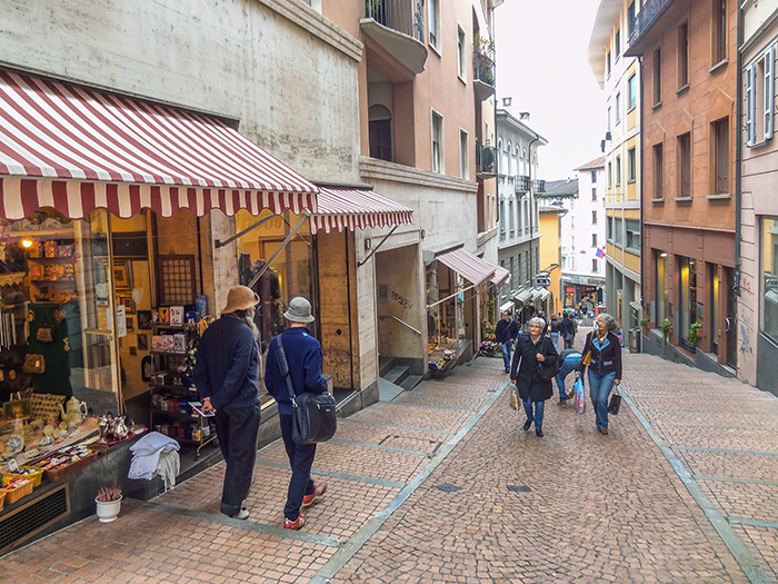 people walking on a street, one of the best things to do in Lugano Switzerland