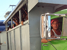 A truck bus on the outskirts of the city in Cuba