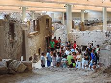 A tour group in Akrotiri in Santorini