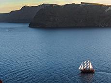 Sunset cruise below Oia in Santorini