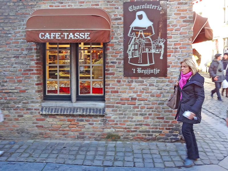 woman walking past a choclate shop
