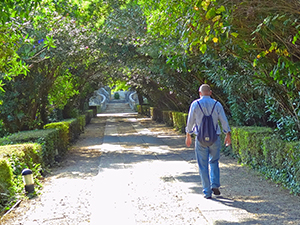 Man walking through the Gardens of the Quinta das Lágrimas hotel