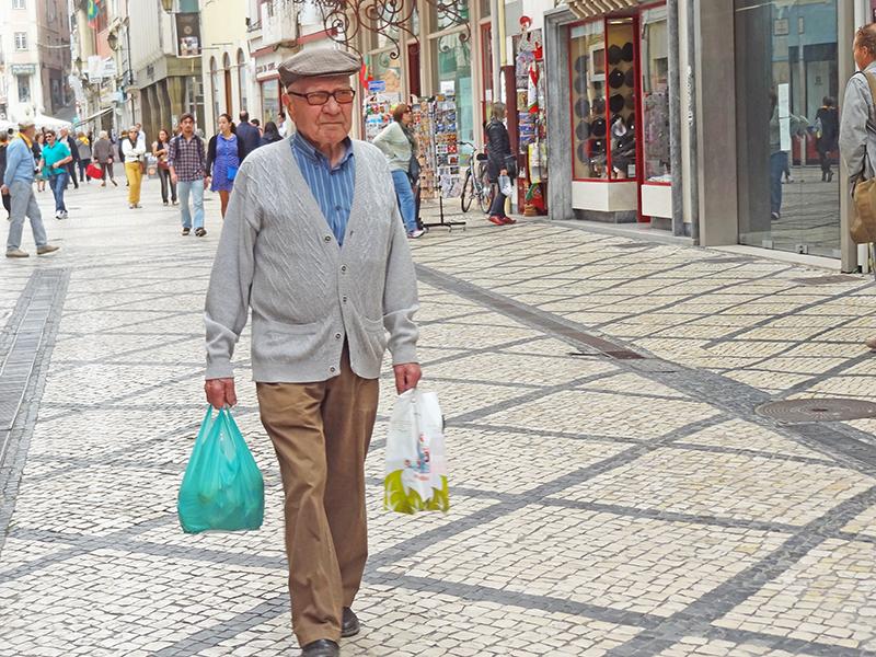 man awalking along a street in Coimbra