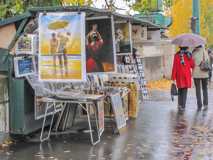 a cart with posters in Paris seen during walks in Paris