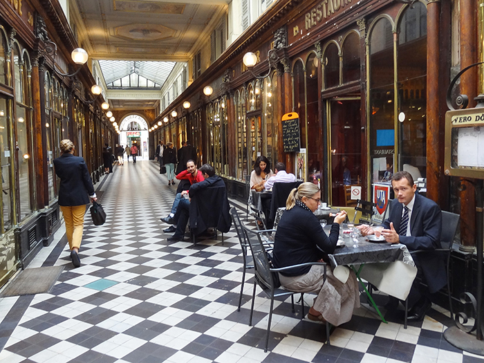 people at a cafe seenduring walks in Paris