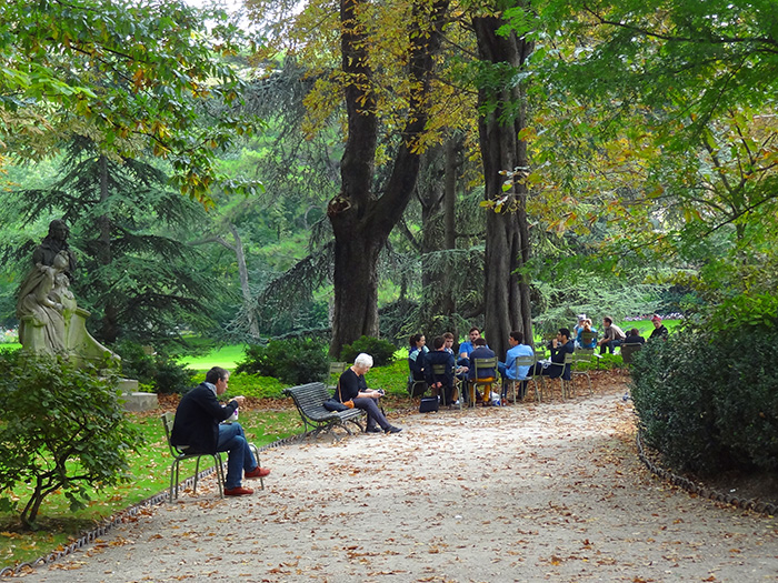 people on chairs in a park seen during walks in Paris